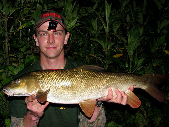 Andrew Kennedy with a Barbel caught fishing traditional freelined luncheon meat