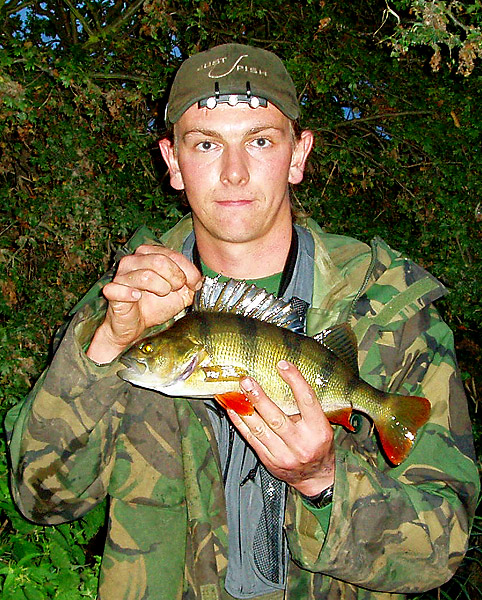 Andrew Kennedy with a Perch caught on the same fishing session as a barbel