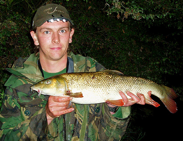 Andrew Kennedy nwith a Barbel caught from the same swim as his earlier Perch